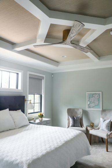 In the couple's master bedroom, they opted for a cool take on a coffered ceiling — which is also wallpapered.