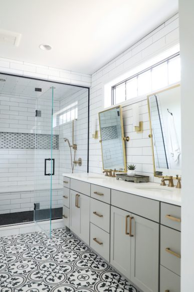 """The Trudgeons love the contrast of a black and white palette,"" says Figaro. ""Because the flooring was the bolder element in the master bathroom, we were understated with some of the other accents [in here]."" One of the couple's must-haves was the steam shower."