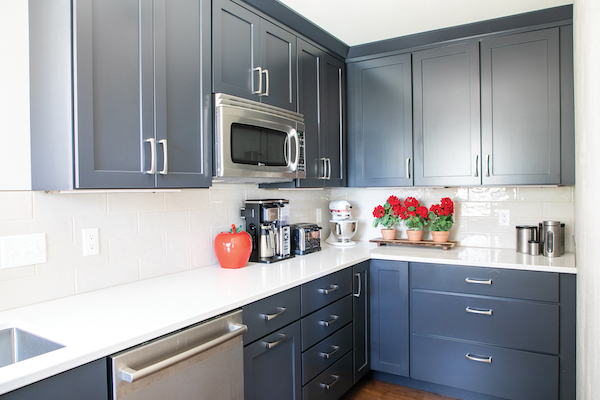 Behind the wine bar is the scullery, with its handsome navy cabinetry that adds in a pop of the unexpected.
