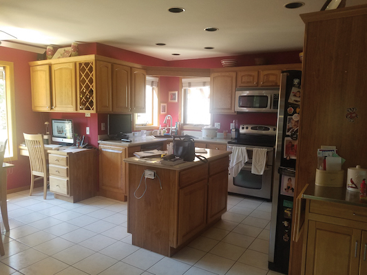 Before, the kitchen island was too small and cramped the flow of the space.