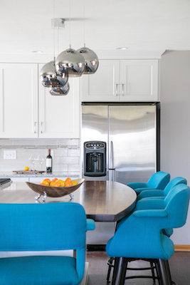 """By installing a larger island, plus adding in the scullery, the room opened up and provides the family more storage. """"Deb [Corning] came over many times and just sat and saw us interact in the space while we were talking through design ideas. So I think it's really important to use designers in that way — they can visualize the space for you,"""" says Joy."""