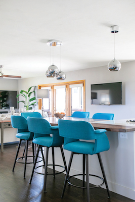 After, the family is so happy with the light, bright feel of the space — and no fireplace blocking the views. Two TVs were installed in the kitchen and family room since the family loves to watch sports.