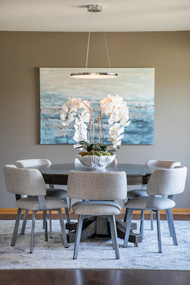 With newly painted walls and stained floors, plus a new throw rug and artwork, the Geenen's dining room looks totally different from its dated past. Chairs from Rubin's, a pendant light from Madison Lighting and artwork from Décor (Corning's home accessories shop), was also peppered in.