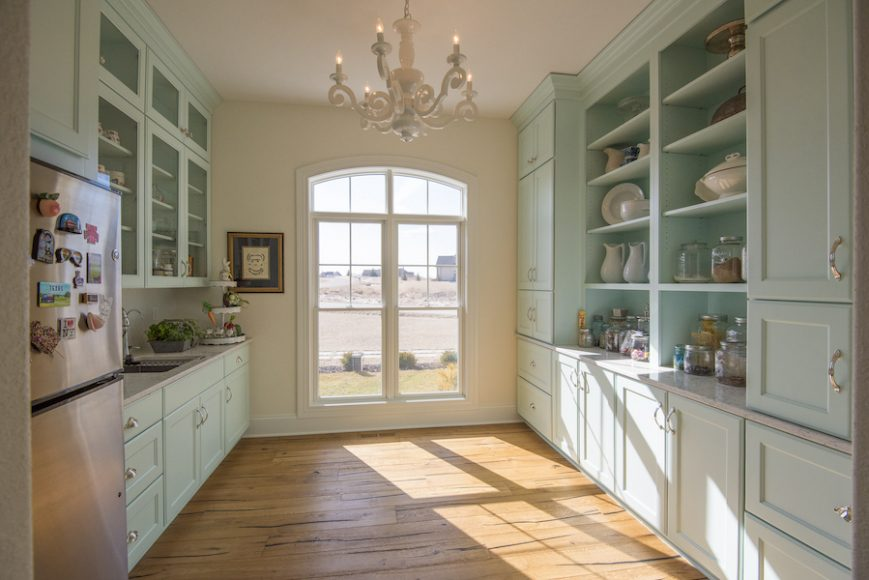 A customized butler pantry from the Brooklyn-style design plan keeps clutter out of the main kitchen and adds tons of useful storage.