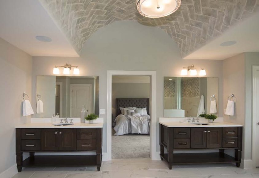 A highly customized owner's suite bathroom reveals the innovative design options that are available to homeowners
